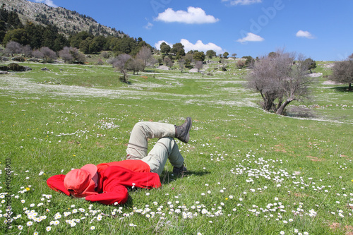 Red dressed person on a meadow