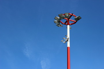 Airport lights on blue sky