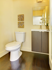 Small simple yellow moern bathroom.