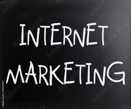 """Internet marketing"" handwritten with white chalk on a blackboar"
