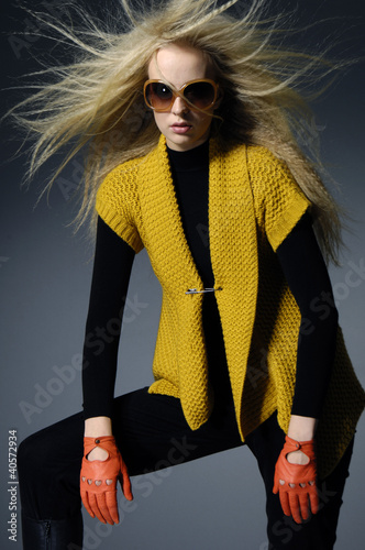 fashion model with long hair on light background