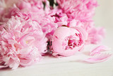 Fototapety Pink peony flowers on wood surface