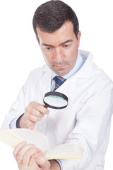 man holding a magnifying glass  and book