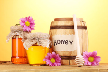 Sweet honey in barrel and jars with drizzler