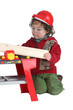 Child playing with a toy workbench