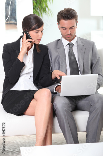 Couple with phone and laptop