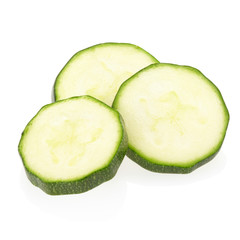 Sliced zucchini on white, clipping path included