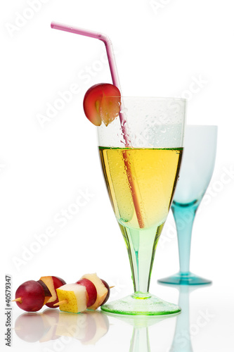 Cocktail still life with colored glass, drink and canape