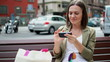 Young woman using smartphone in the city