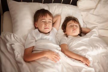 Children sleeping in bed