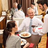 Business lunch waiter serving red wine poster