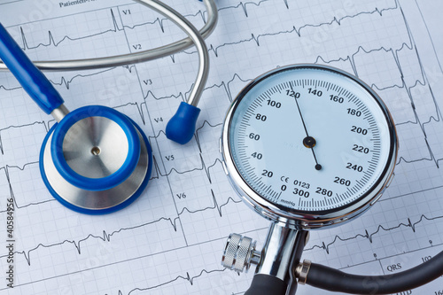 canvas print picture Blutdruck Messung und EKG Kurve.