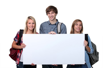 Teenager holding white board