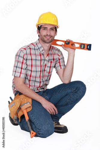 happy carpenter holding ruler