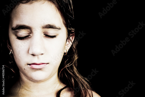 Dramatic portrait of a very sad girl crying