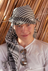 Portrait of young man in keffiyeh
