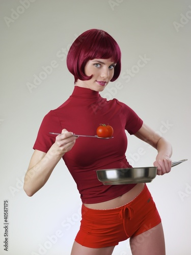 The girl in red clothes on a light background