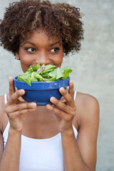 pretty African American woman with salad, healthy lifestyle