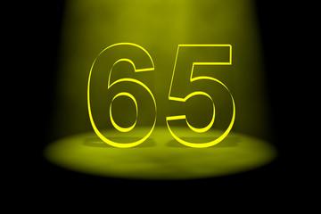 Number 65 illuminated with yellow light