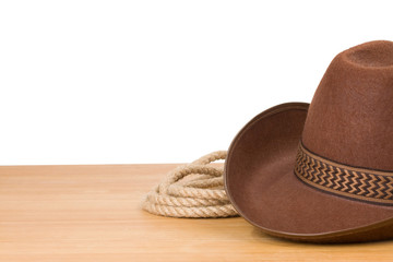 cowboy hat and rope isolated on white