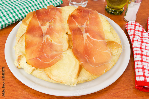 pizza with ham and smoked cheese