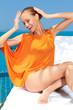 Fashion woman posing next to pool
