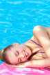 Beautiful woman lying close to pool