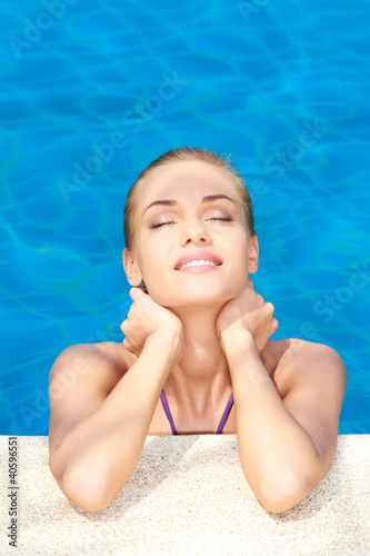 Dreaming woman in swimming pool
