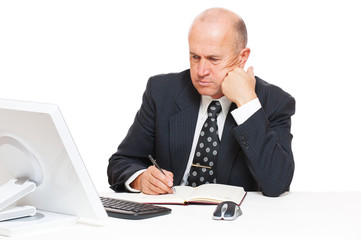 studio picture of pensive businessman with computer