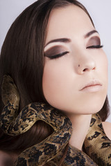beautiful brunette girl with a snake