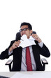 Angry businessman ripping a paper