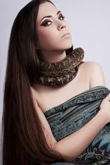 beautiful brunette girl with a snake around her neck