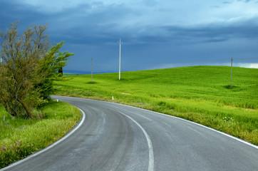 Italian road, oncoming storm