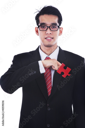 Businessman with a piece of puzzle
