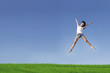 Excited woman jumping over blue sky