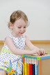 Little girl playing in a developing toy
