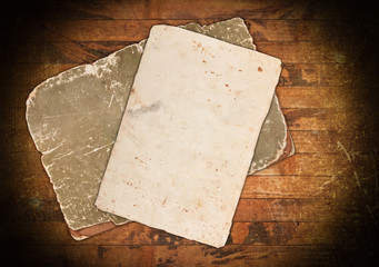 Faded grungy papers on wood