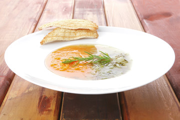 dual components vegetable soup with toasts