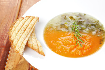 dual components vegetable soup served with toasts