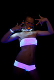 sexy girl with glow make-up in ultraviolet light poster