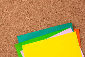 colorful note paper on corkboard