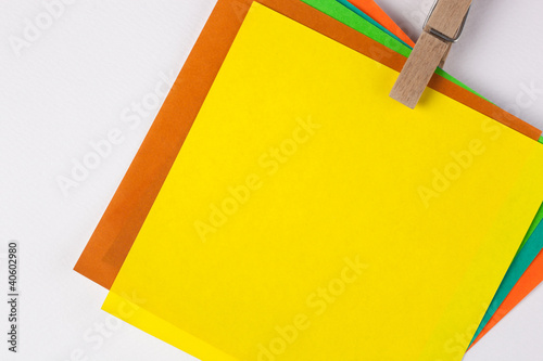 colorful note paper with wooden clip