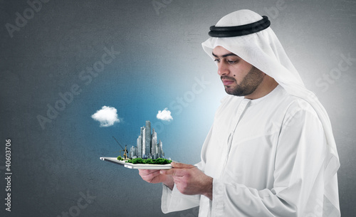 arabian businessman with a virtual city presentation on a pad