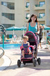 mother with  pram  walking  at resort