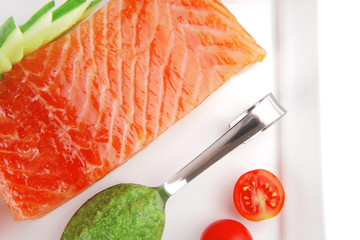 salmon fillet with vegetables and pesto sauce