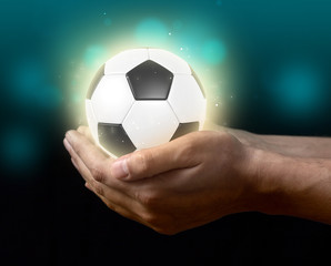soccer ball on hand
