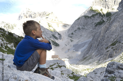 Little boy admiring mountain landscape