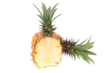 whole and half pineapples