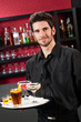Professional barman cocktail bar hold serving tray