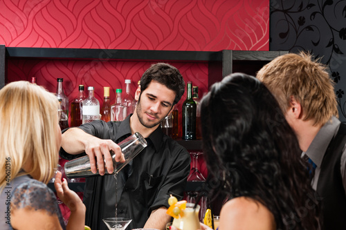 Barman prepare cocktail friends drinking at bar